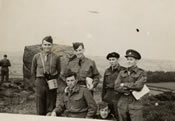 "A group of friends at the British War College: Tom Dustin, Dad, Doug. Stuebing and Larry Wilson. Kneeling are Tony...(?) and Harold Basso. Dad wrote on the back, ""Larry and Tony are my roommates. Both are swell people."