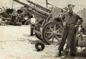 "1944 Cassino, Italy. A German gun park. I believe the artillery piece behind dad is the famous ""German 88""--a fearful and deadly weapon."