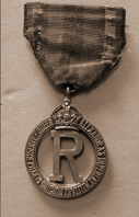 Queen Alexandra's Imperial Military Nursing Reserve cape badge of Staff Nurse May Palmer