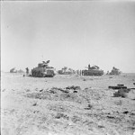 Tanks of 8th Armoured Brigade waiting just behind the forward positions near El Alamein before being called to join the battle, 27 October 1942.