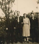 Leslie with Mother, Father and Brother as this was the age he would have been when he was serving on the Strathallan. Leslie is seen here standing next to his Mother, she is holding his arm.