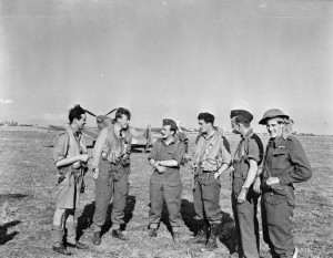"Operation TORCH: Squadron Leader R ""Raz"" Berry (third from left), the Commanding Officer of No. 81 Squadron RAF, with some of his pilots at Maison Blanche, Algeria, after flying in from Gibraltar to commence operations on the first day of the invasion."